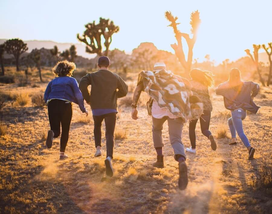 five people running in desert travel nurses exploring after work staff nurse to travel nurse
