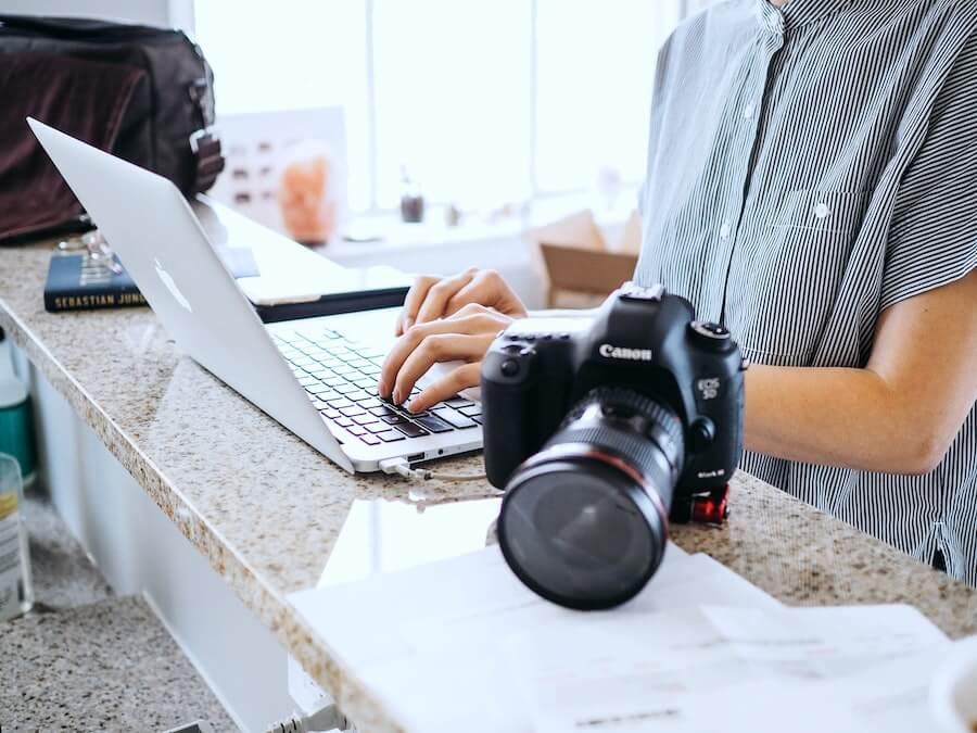 woman looking on computer finishing travel nurse paperwork staff nurse to travel nurse