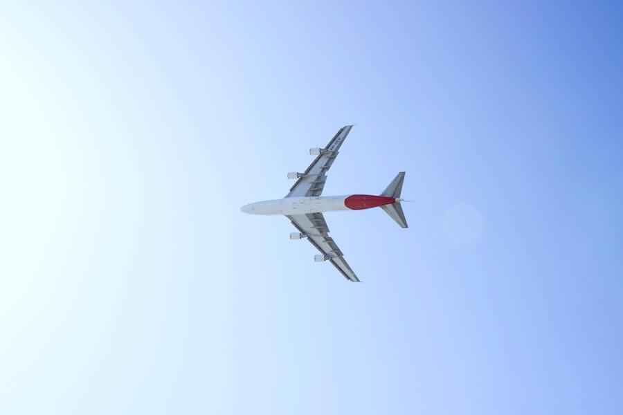 plane in sky on blue-sky background staff nurse to travel nurse
