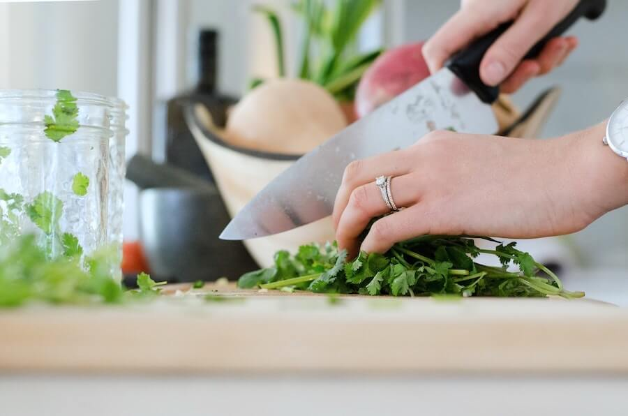 woman cutting cilantro parsley nurse wellness jobs away from the bedside