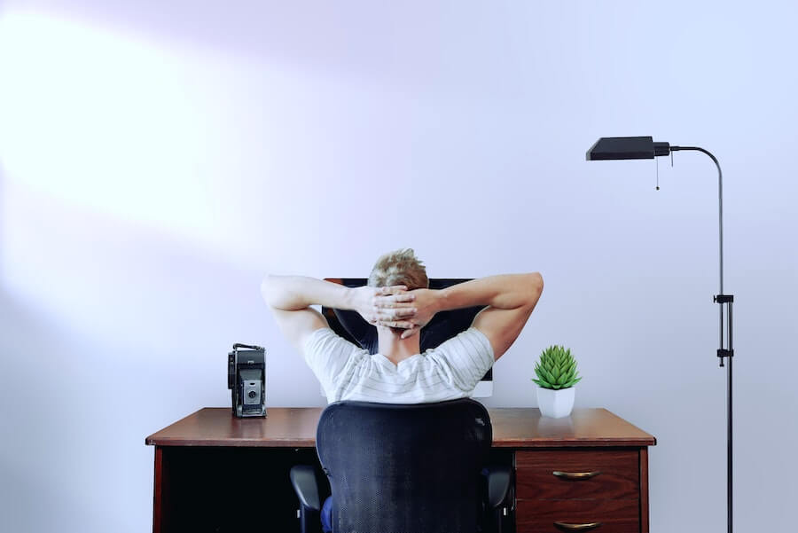 man at desk looking at computer find remote nursing jobs 2021
