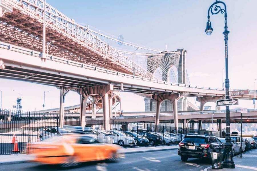 cars driving under bridge in brooklyn travel nurse taxes tax homes