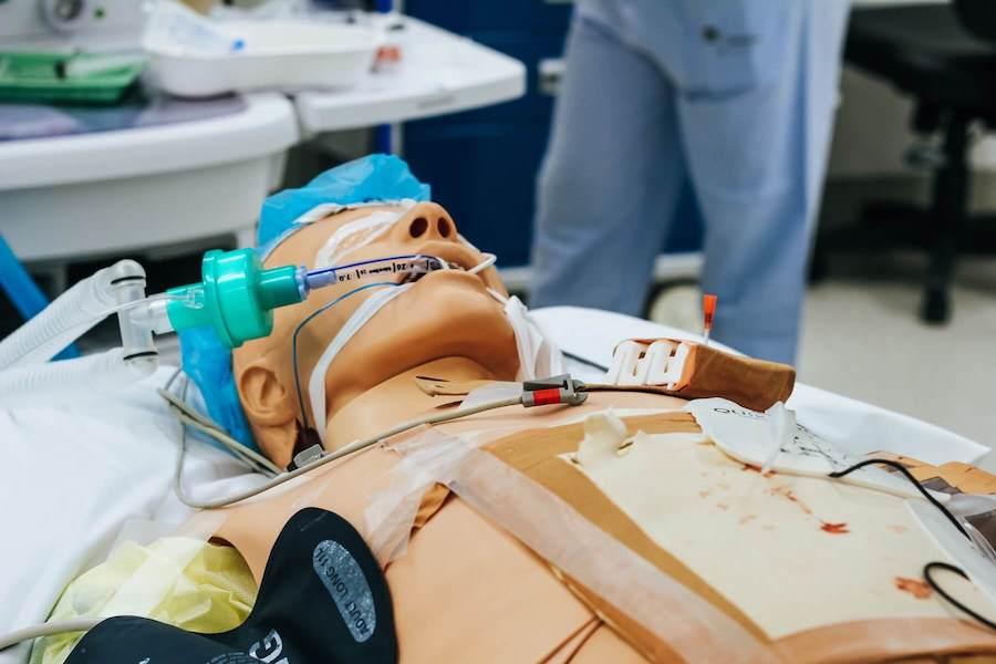 CPR dummy lying on table emergency medicine ER nurse