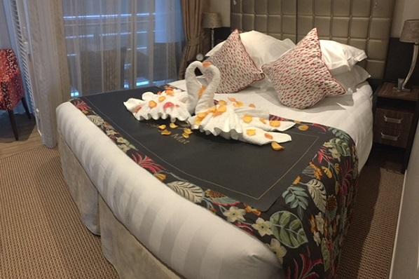AmaKristina Swans On The Bed