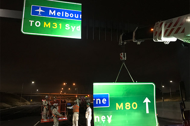 Installing signs on freeway