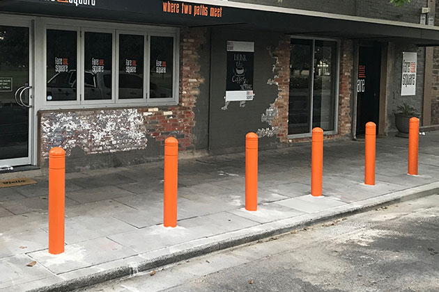 Curbside parking bollards