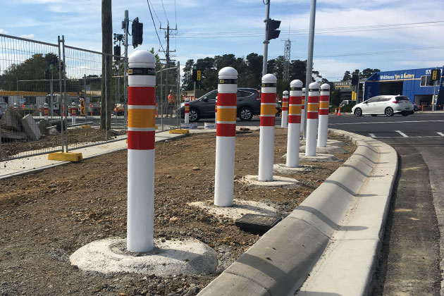 Energy absorbing bollards at intersection