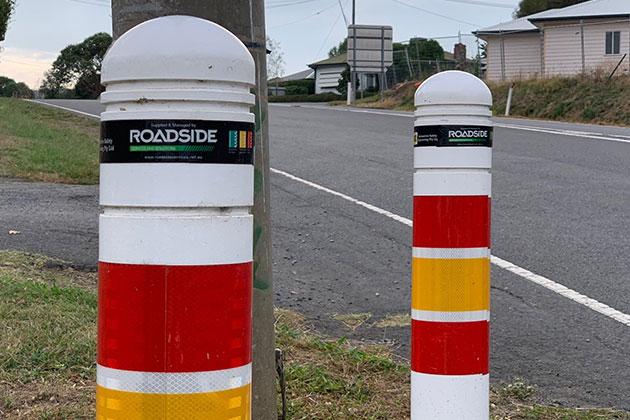 Traffic bollard on island