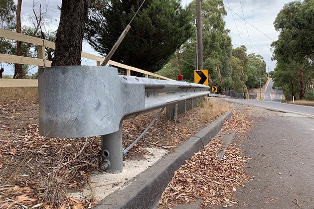 End terminal bollard on guardrail