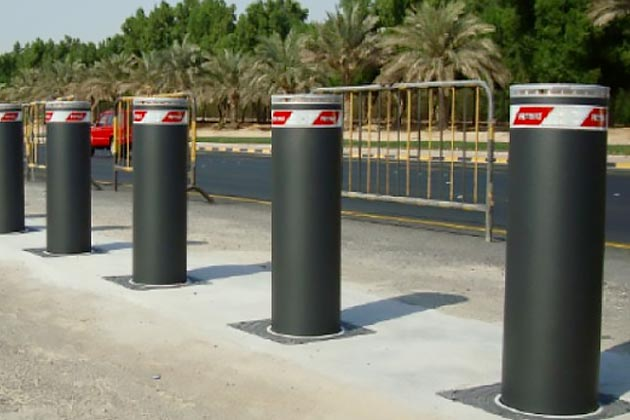 Heavy duty bollards on side of road