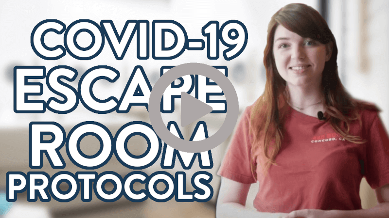 """Woman Smiling Standing Next to Words Saying """"Covid-19 Escape Room Protocols"""""""