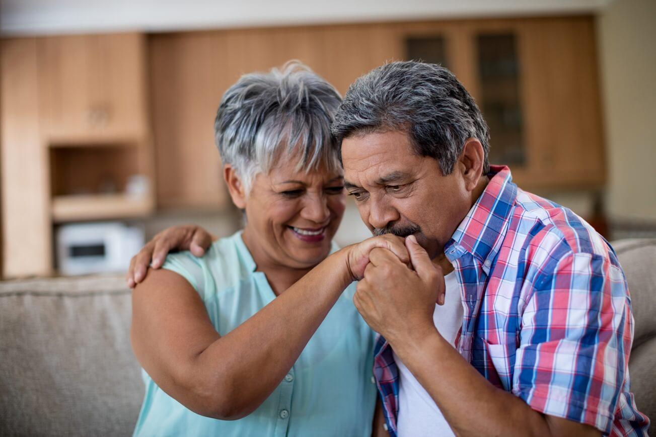 Senior Man Kissing His Partner Hand In Living Trailer Homes For Sale Houston