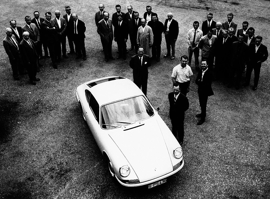 The design team that created the Porsche 911. Ferry Porsche at the front, with son Butzi Porsche and nephew Ferdinand Piech behind. Erwin Komenda and Hans Mezger are in the main group.