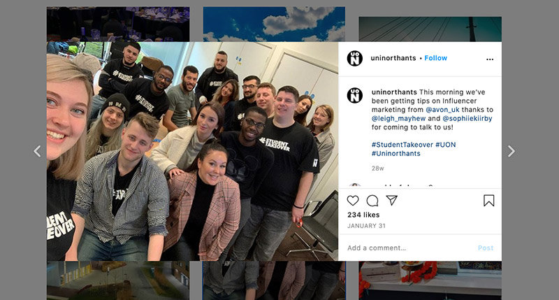 An instagram post from the University of Northampton which shows a photo of a group of students.