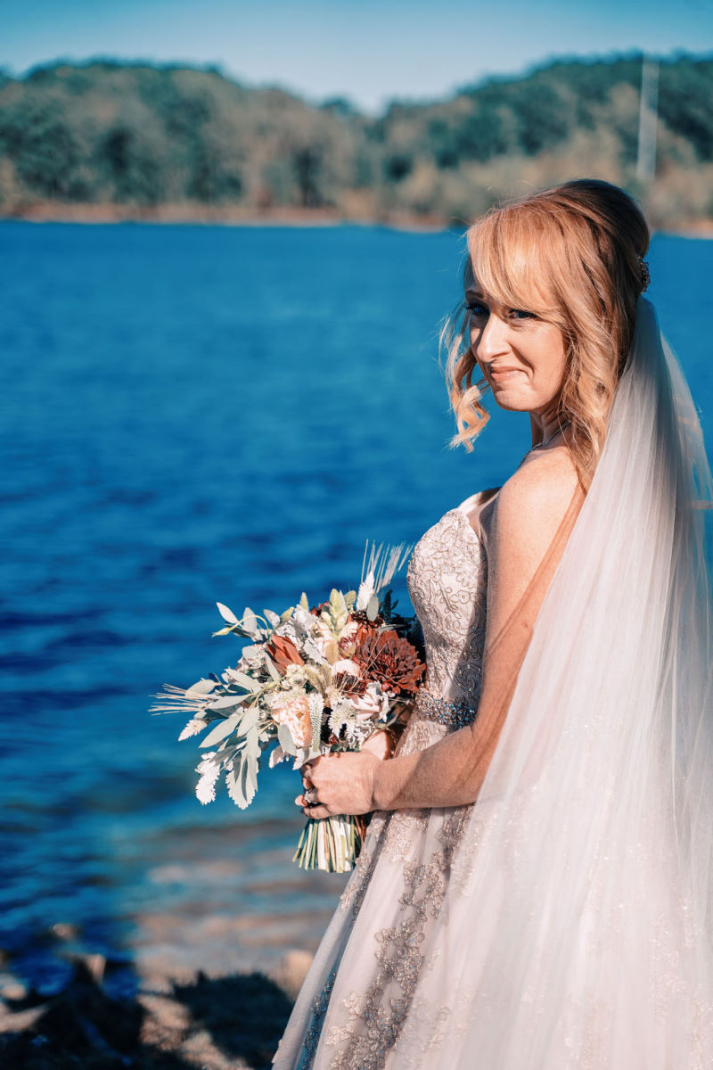 Smiling bride on the water