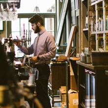 A bartender pulls a pint in a pub
