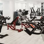 weights and exercise machines on a busy gym floor