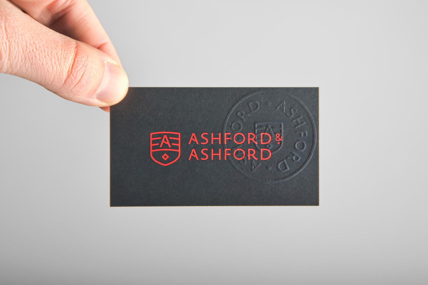 Business card with embossed badge