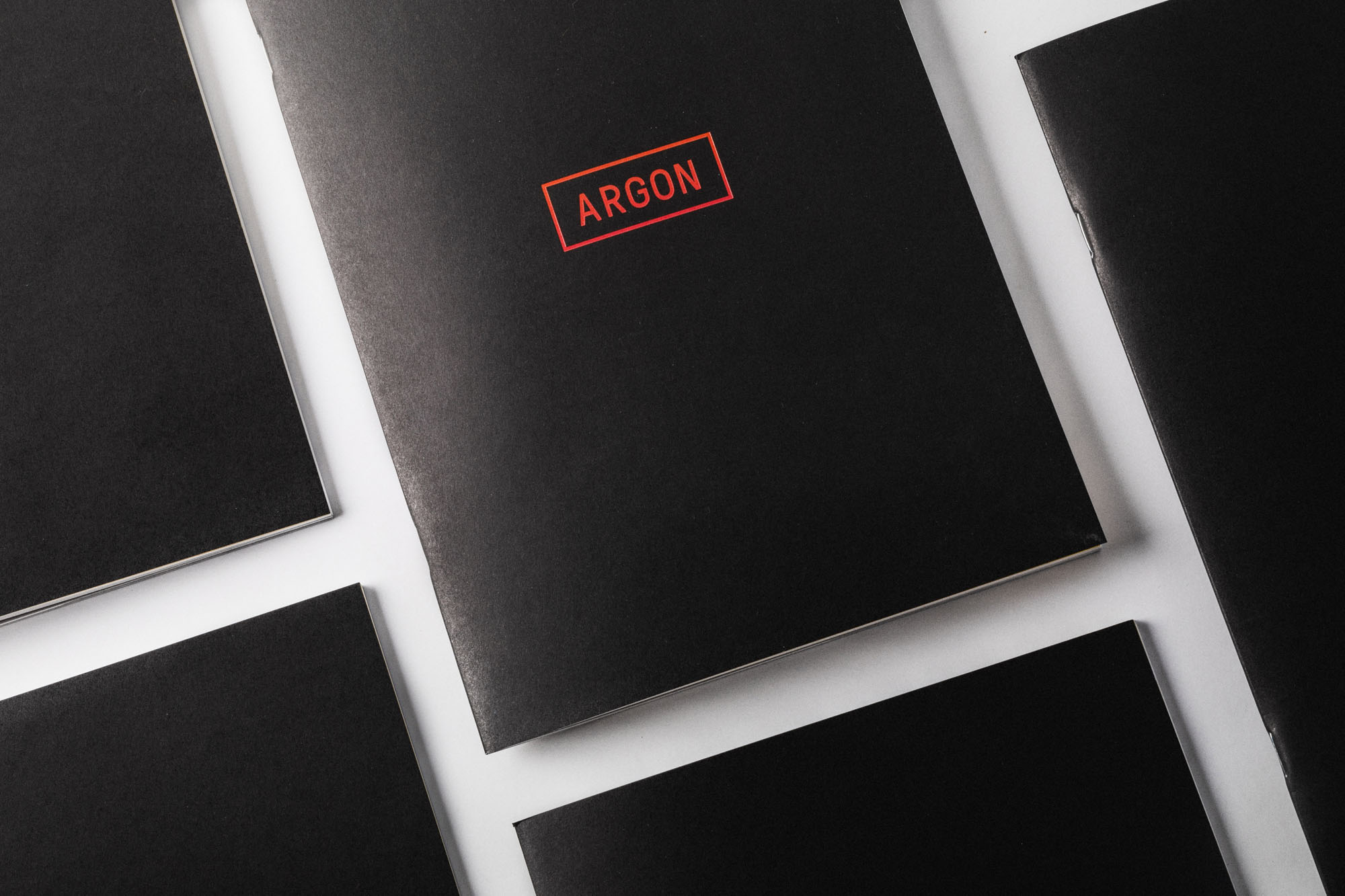 The argon logo, printed on black paper book covers