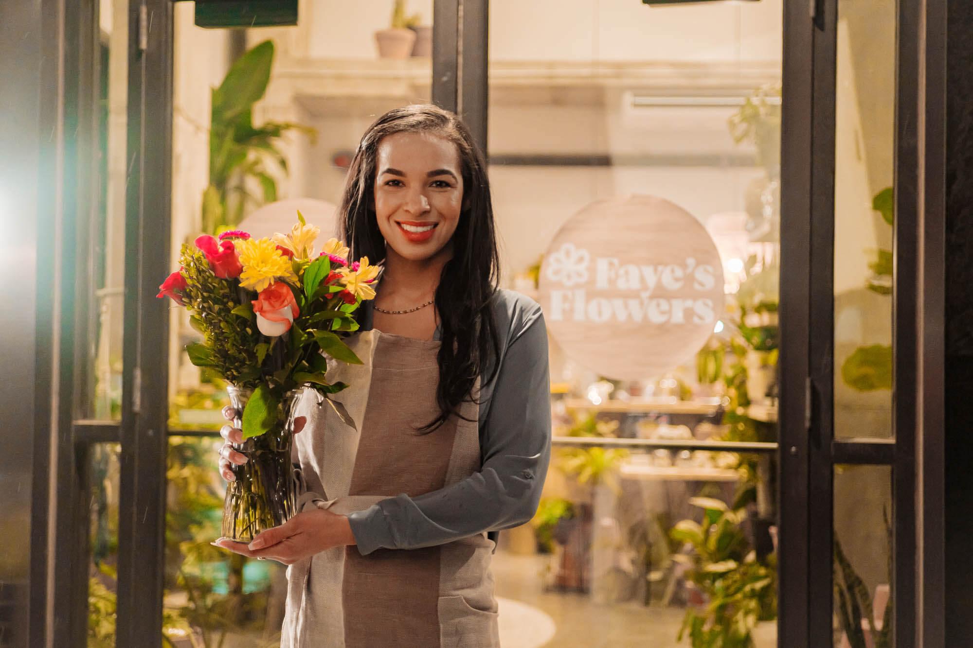 A florist holding flowers