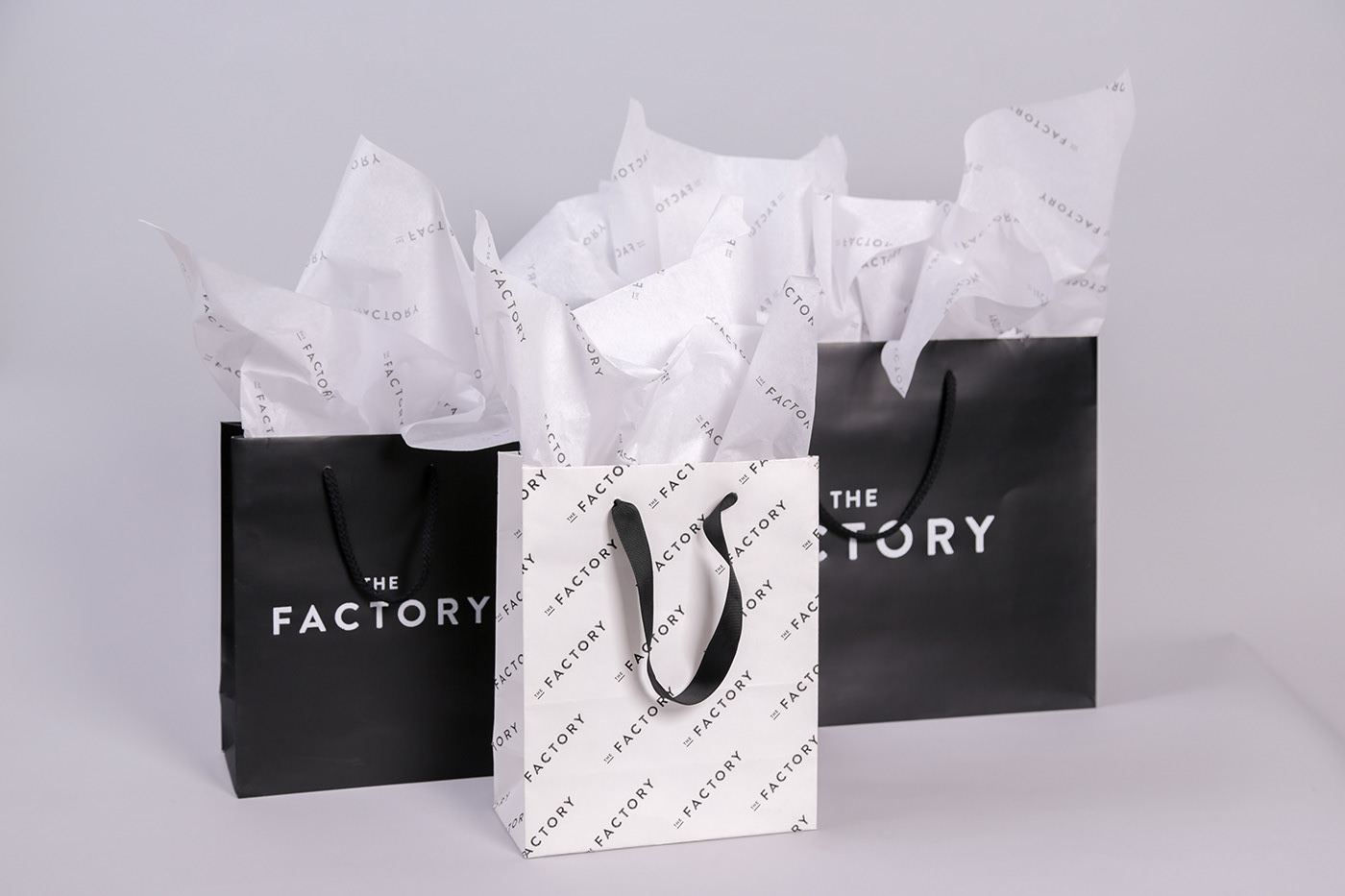 Shopping Bags with logos and branded tissue paper for The Factory