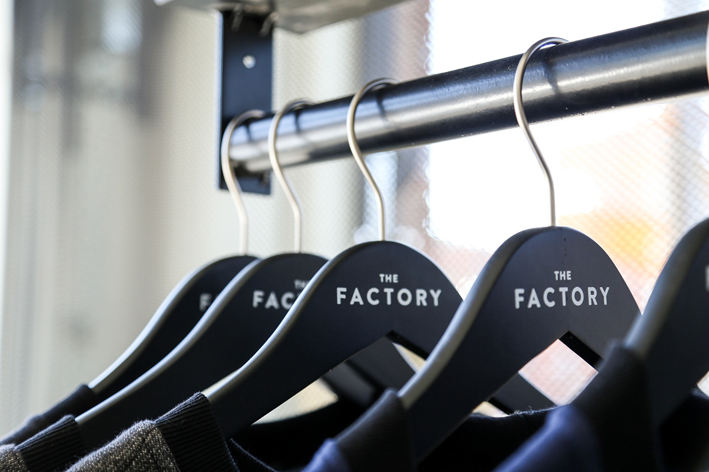 Hangers with an embossed The Factory logo