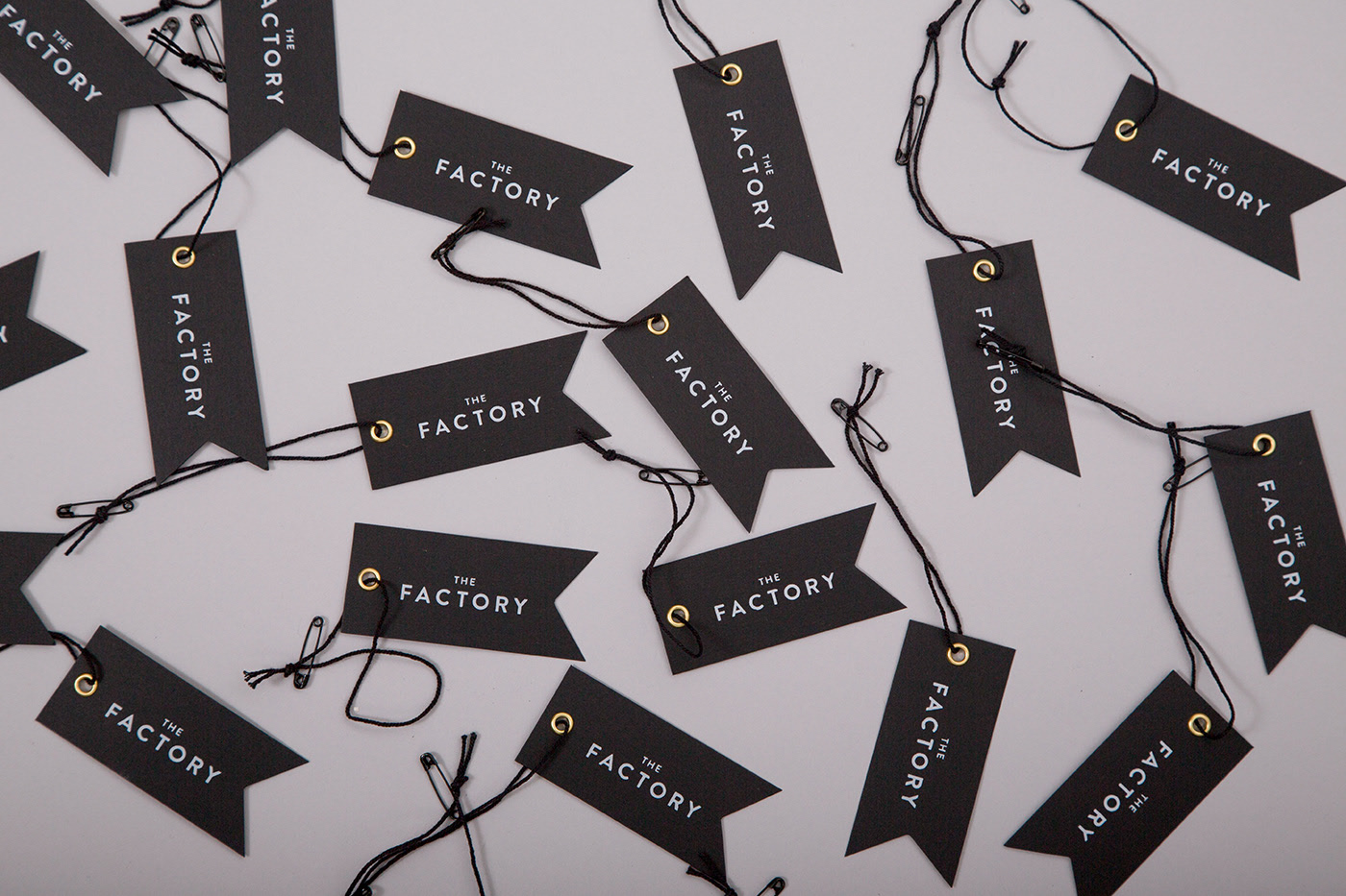 Branded pennant shaped tags for The Factory in Oklahoma City