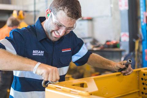 Coxons team member overhauling radiator
