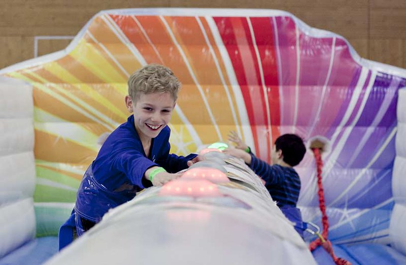 Boy at inflatable castle smiling