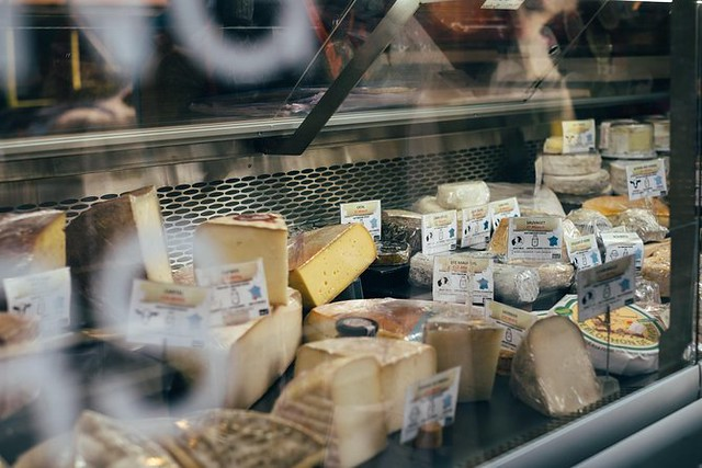 a wide selection of cheeses at a shop