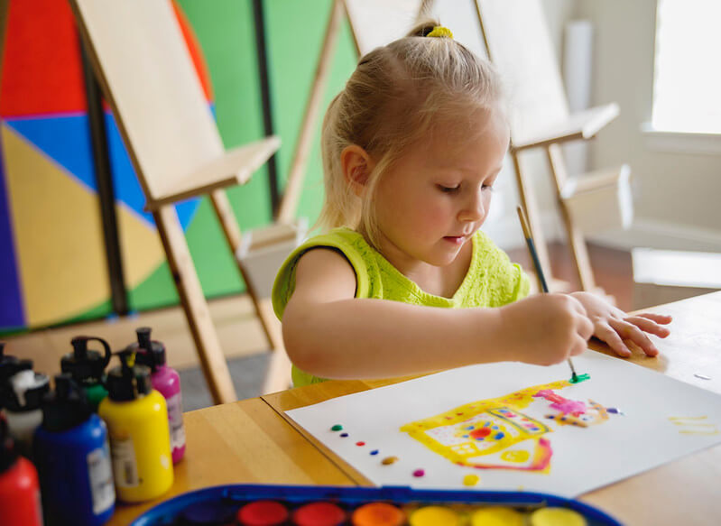 girl painting arts and crafts at home