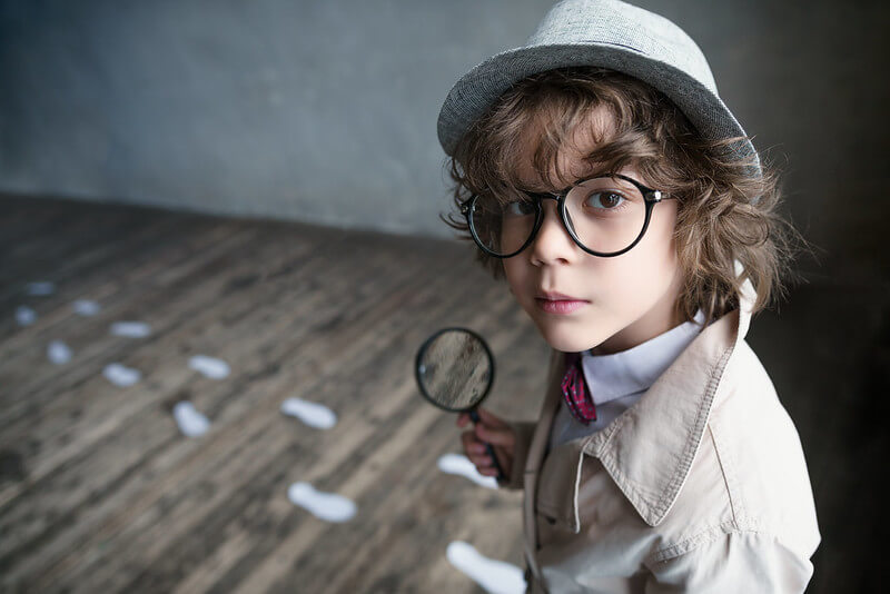 kid playing detective game