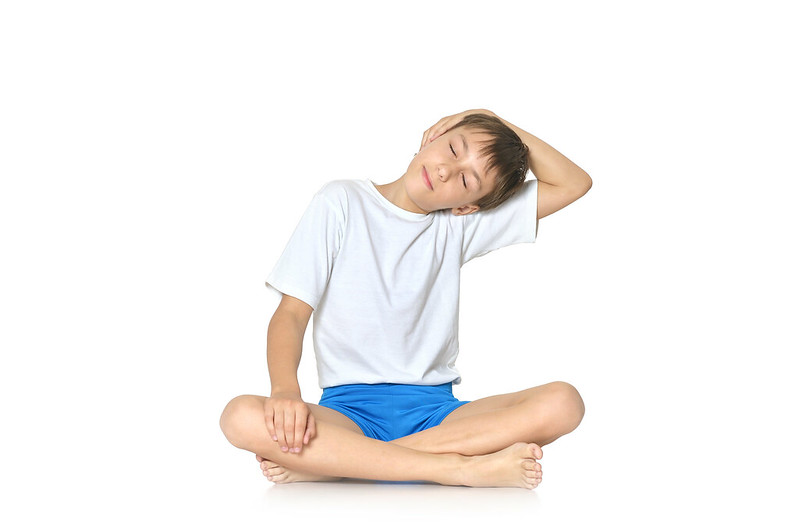 Child stretching out during yoga