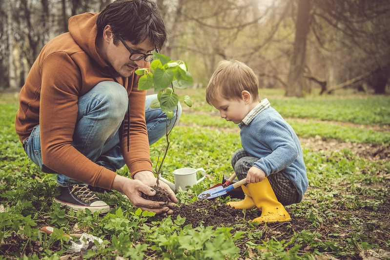 Child gardening with parent