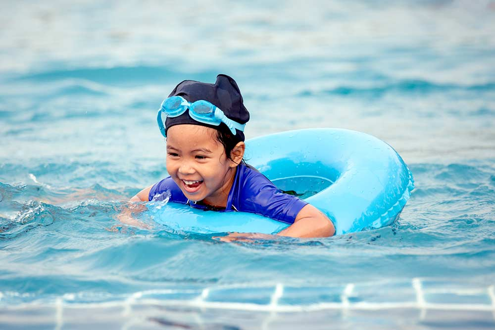 child swimming in rubber ring