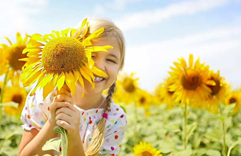 Happy child with sunflower
