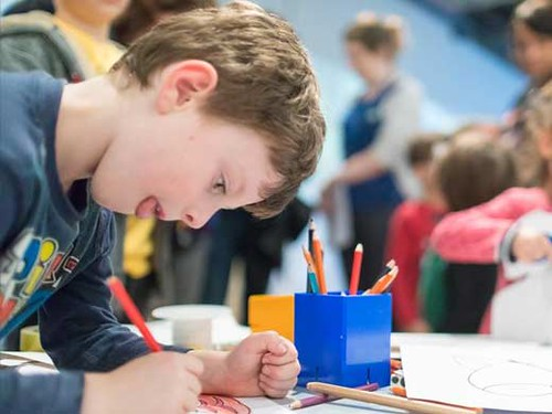 Child concentrating while drawing