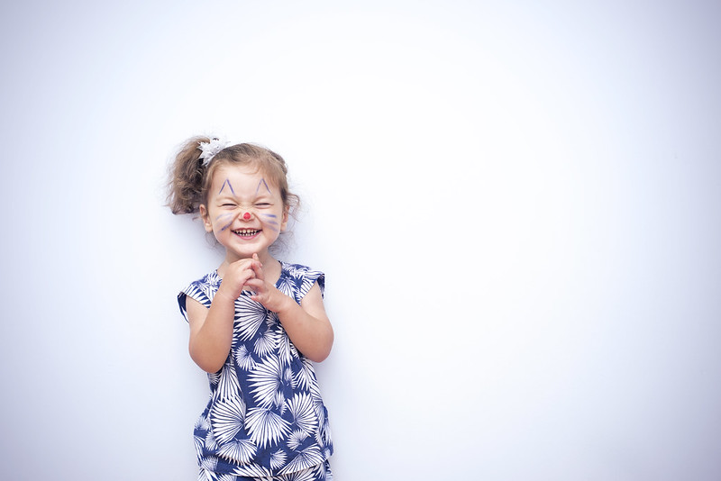 Child dressed as an animal laughing