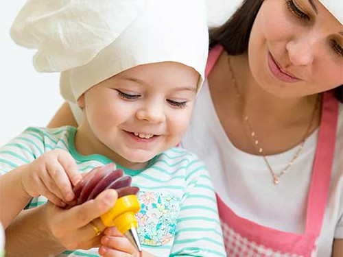 Child and parent baking