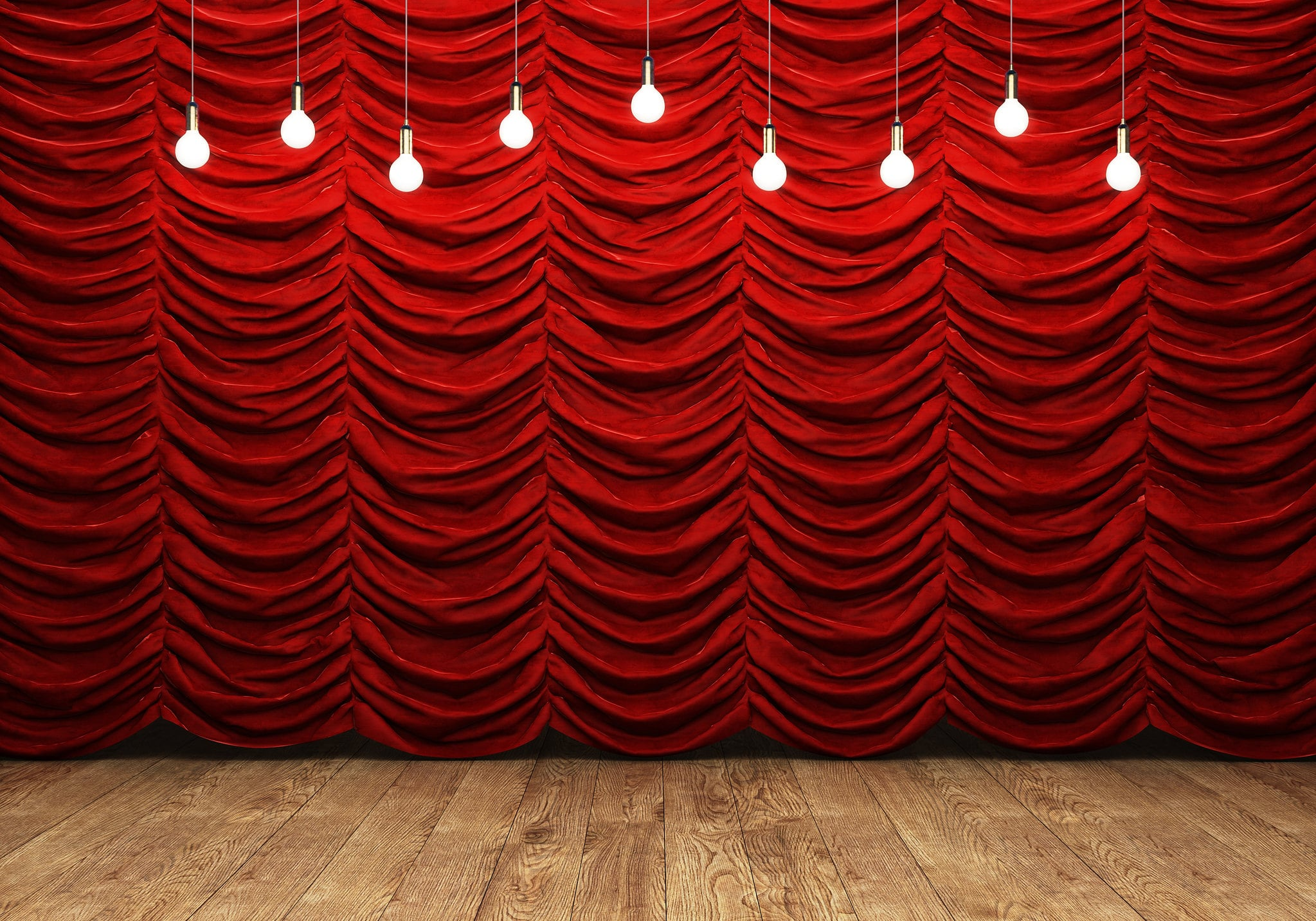 empty stage with red curtain behind it