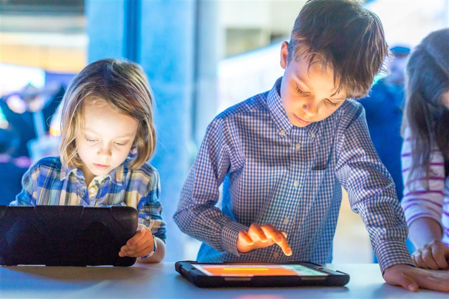 brothers using tablets to practise coding