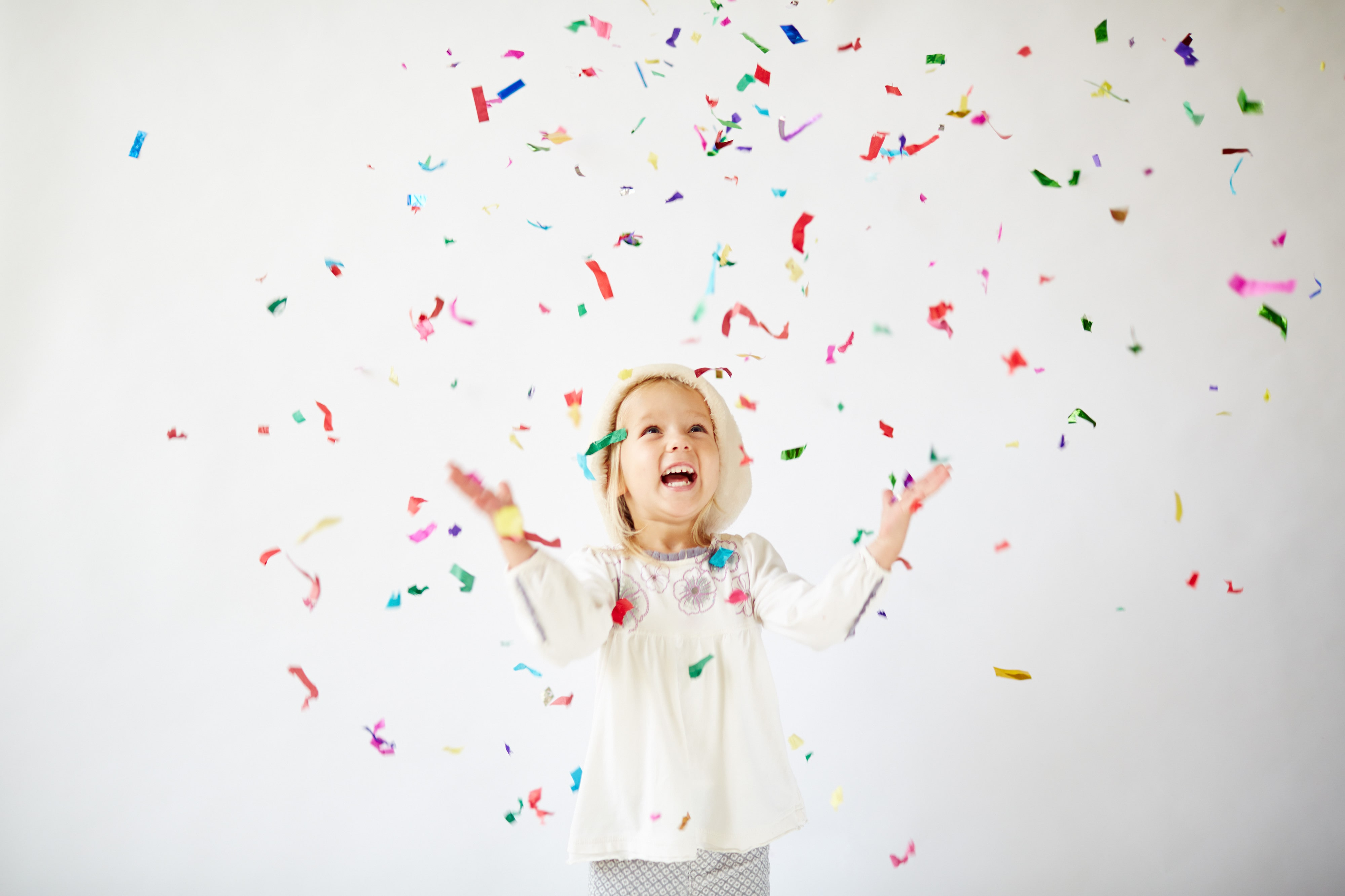 little girl celebrating with confetti