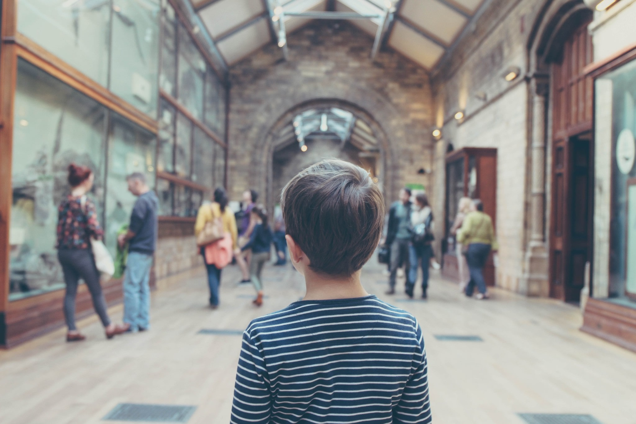 young boy stood in a museum