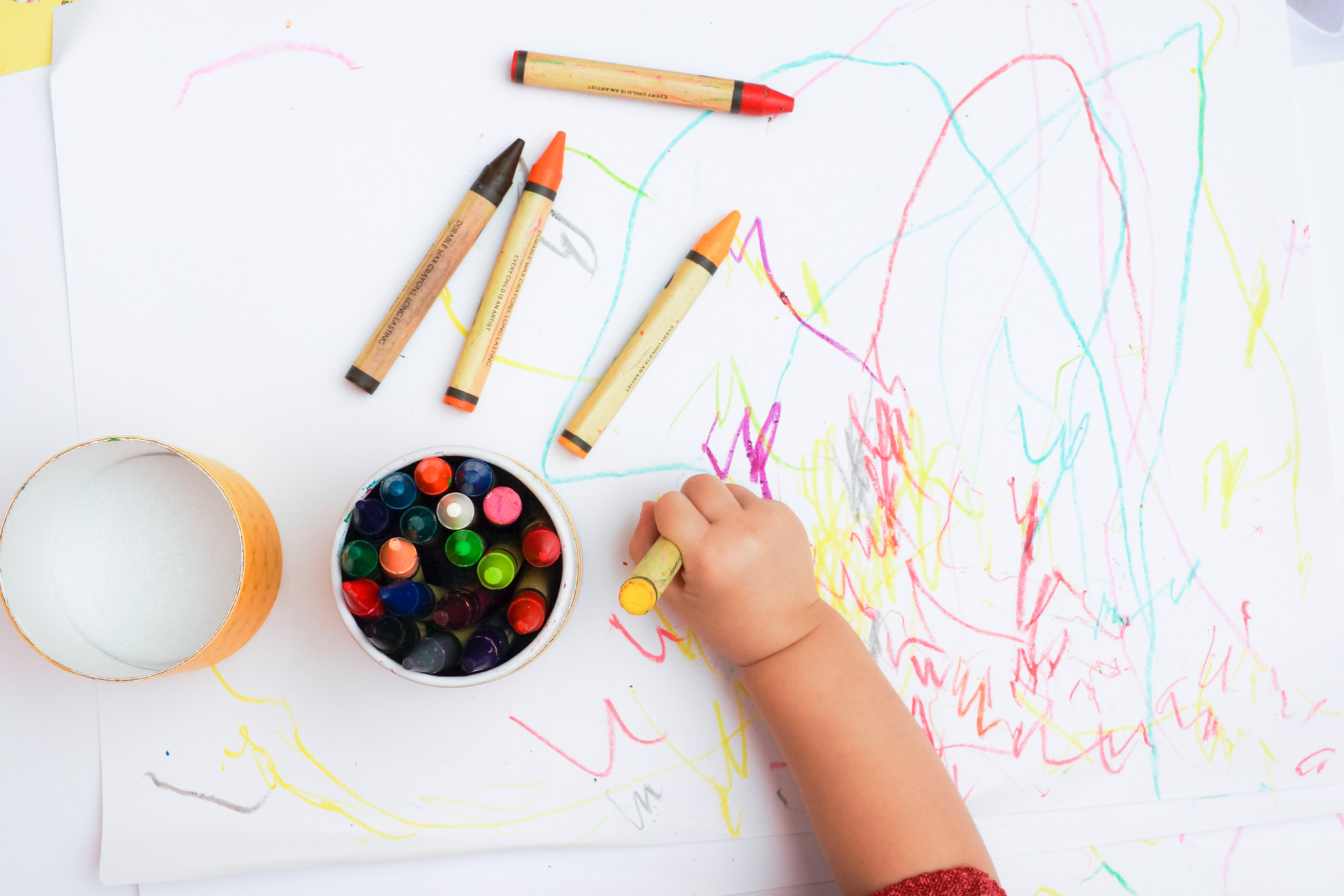 toddler's hand drawing with crayon