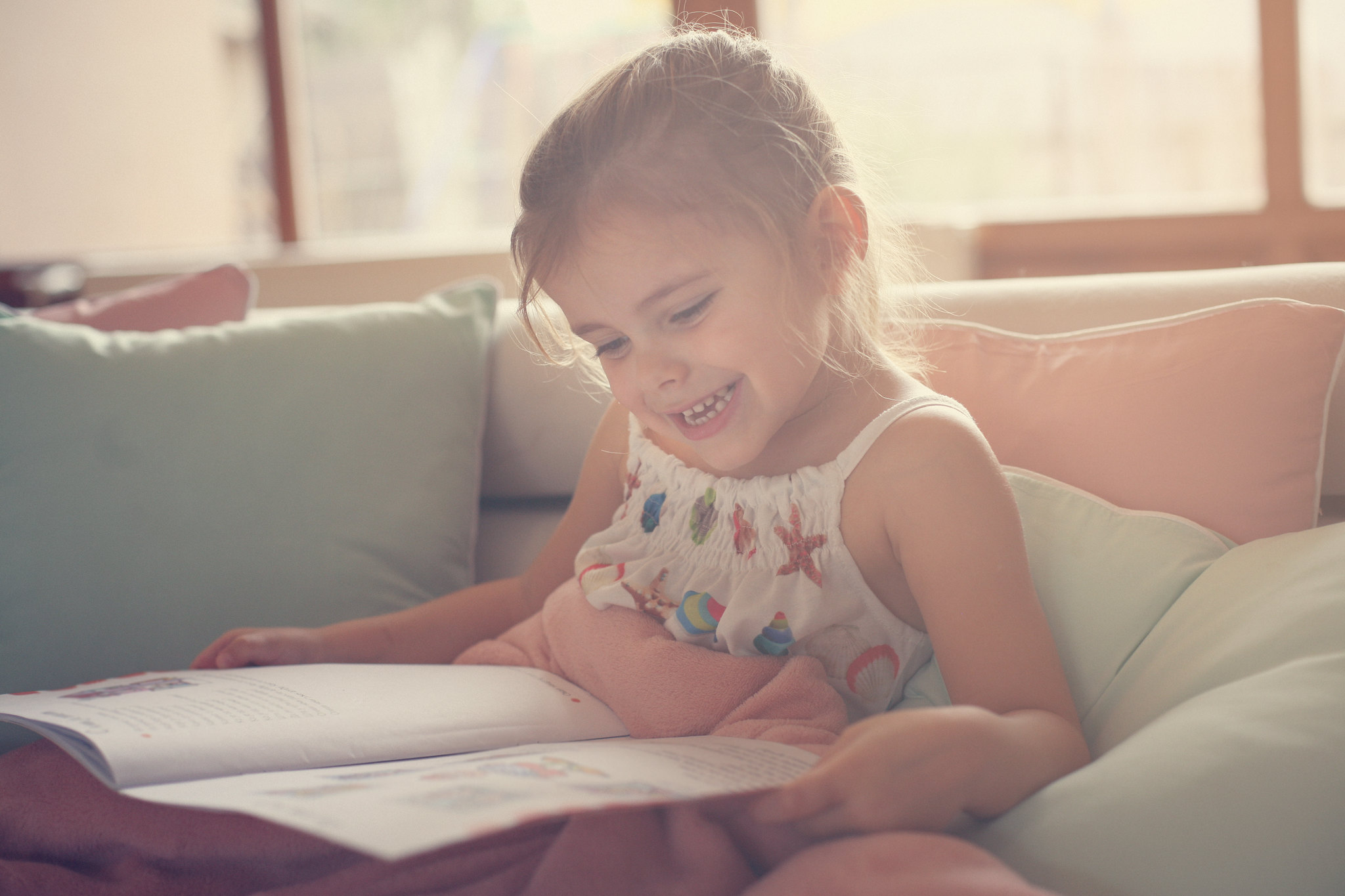 little girl enjoying her book