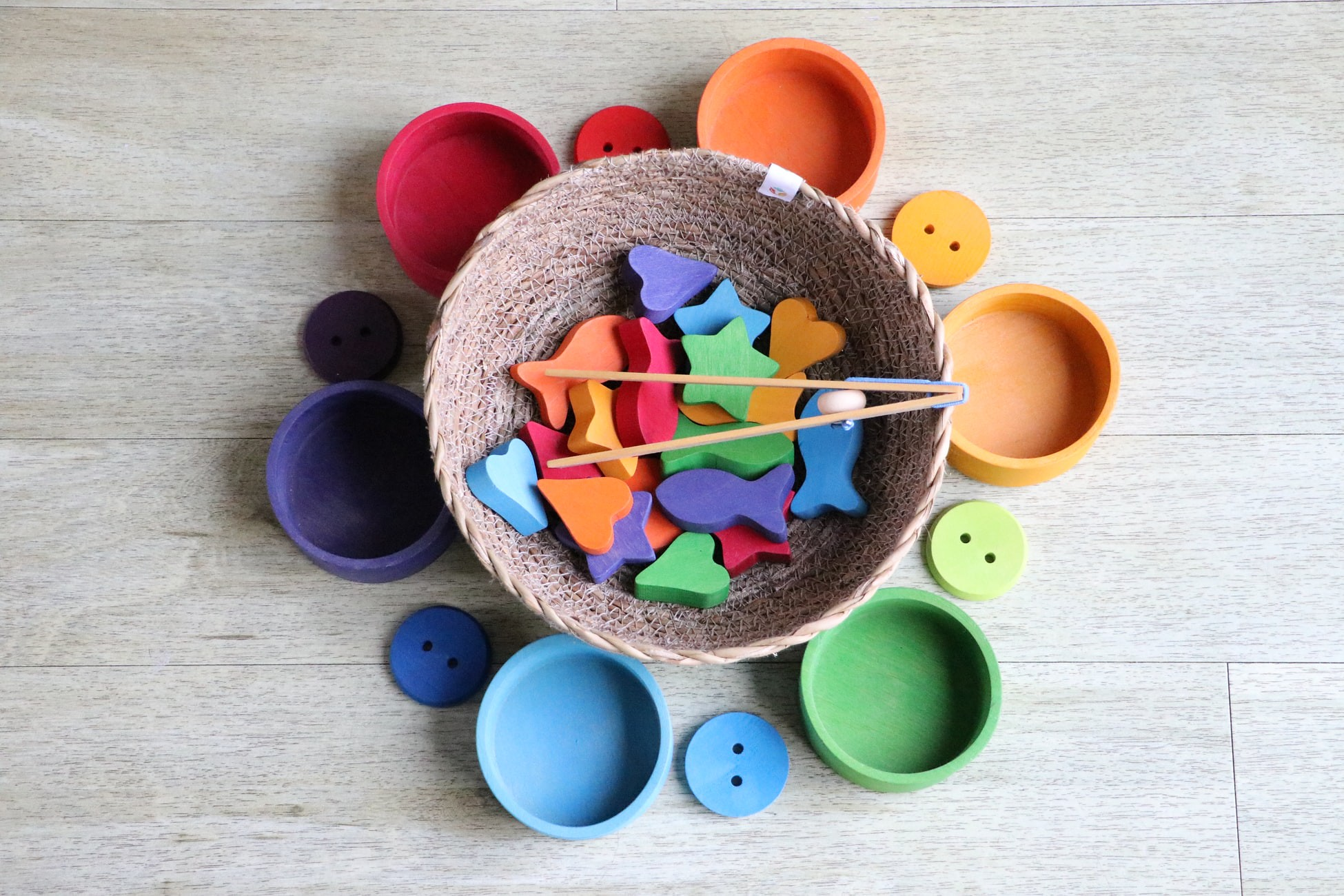 colourful wooden shapes in woven basket