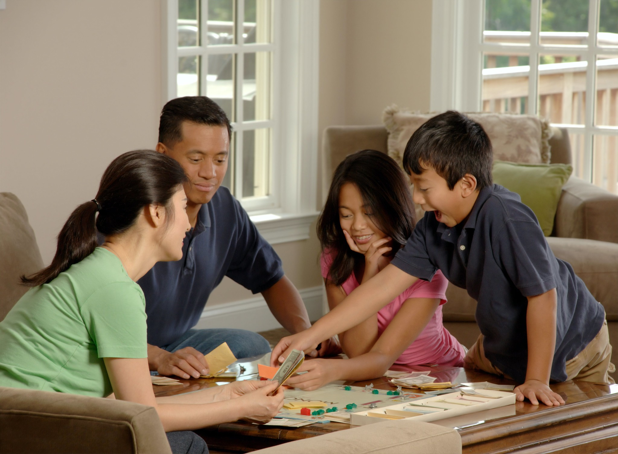 family playing board game togerher