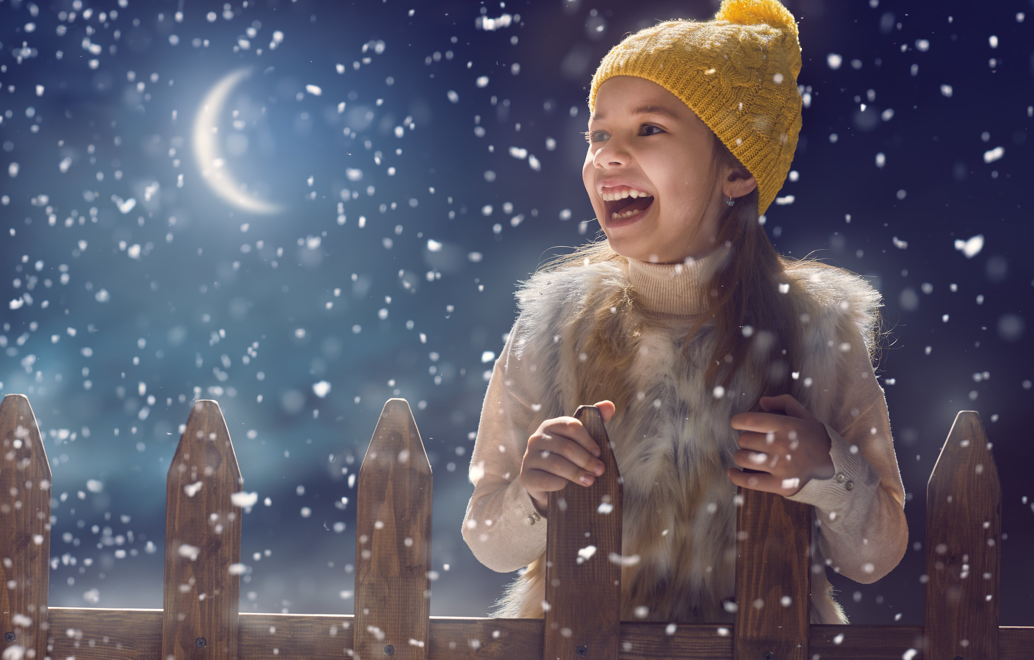 girl laughing in the snow at night