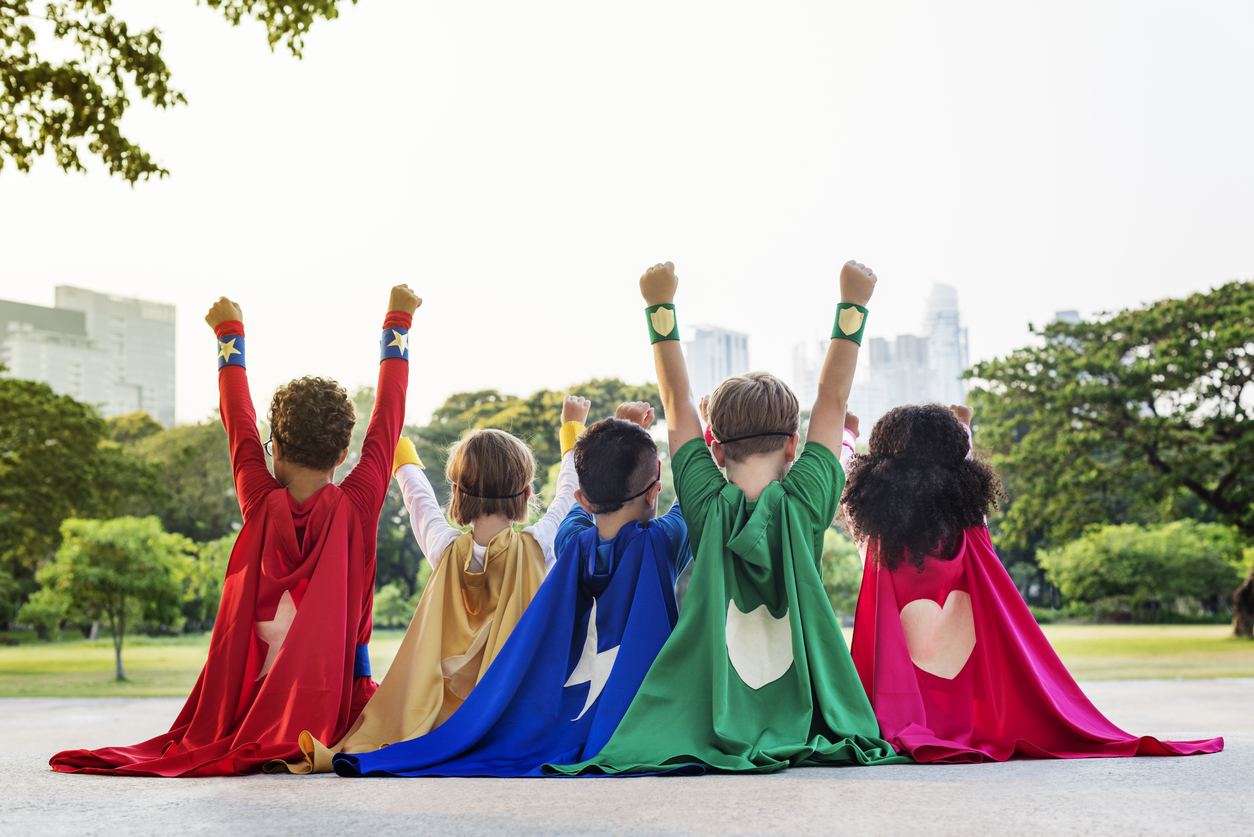 5 children dressed up as superheroes