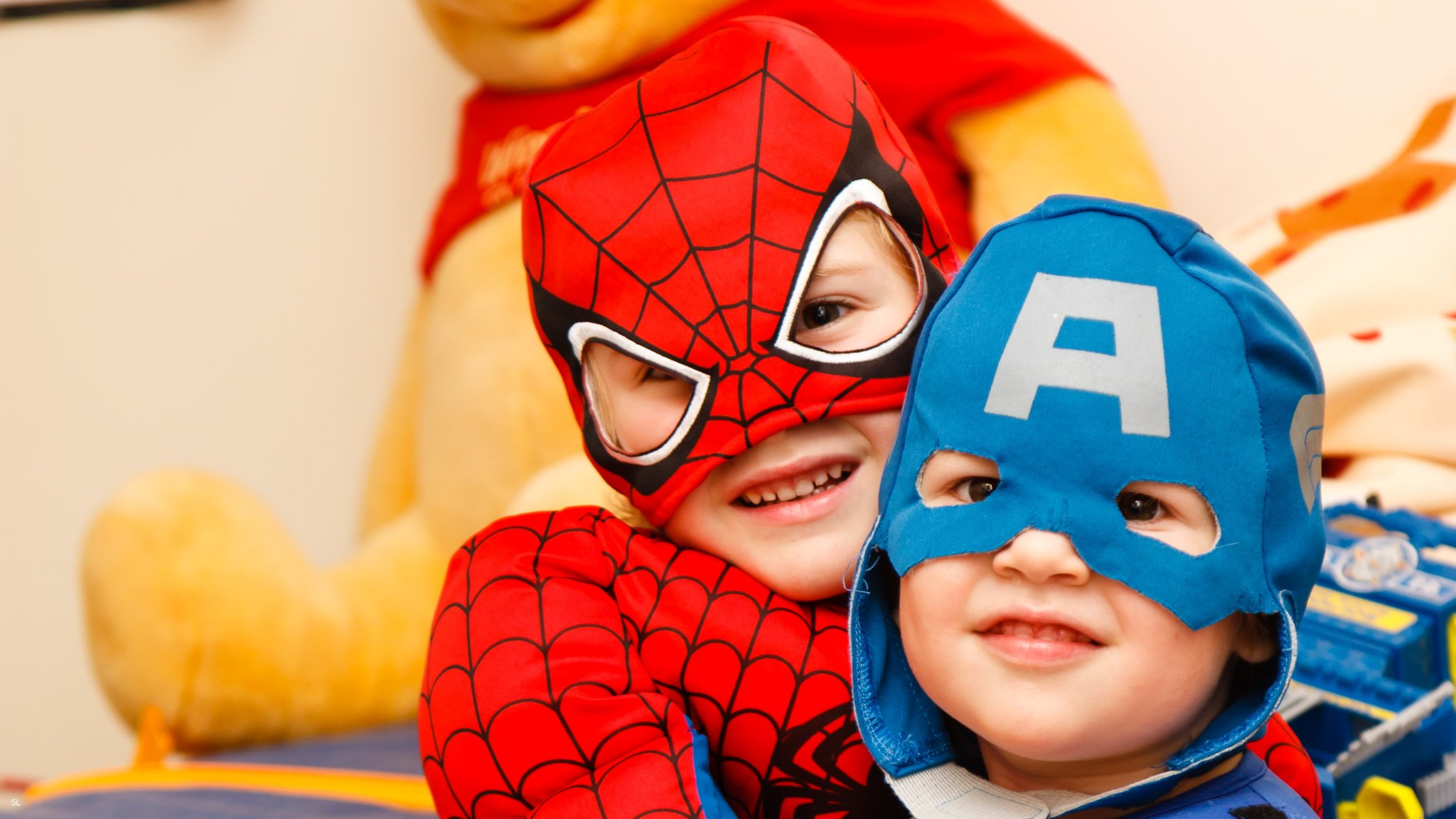 kids dressed up as Spider-Man and Captain America